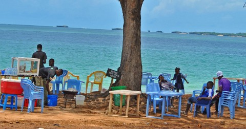 Family relaxes on the beach front. By Rutendo Nyamuda