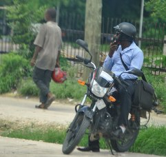 Man chills out on his motorbike, By Rutendo Nyamuda