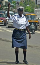 Female officer controlling the traffic. By Rutendo Nyamuda